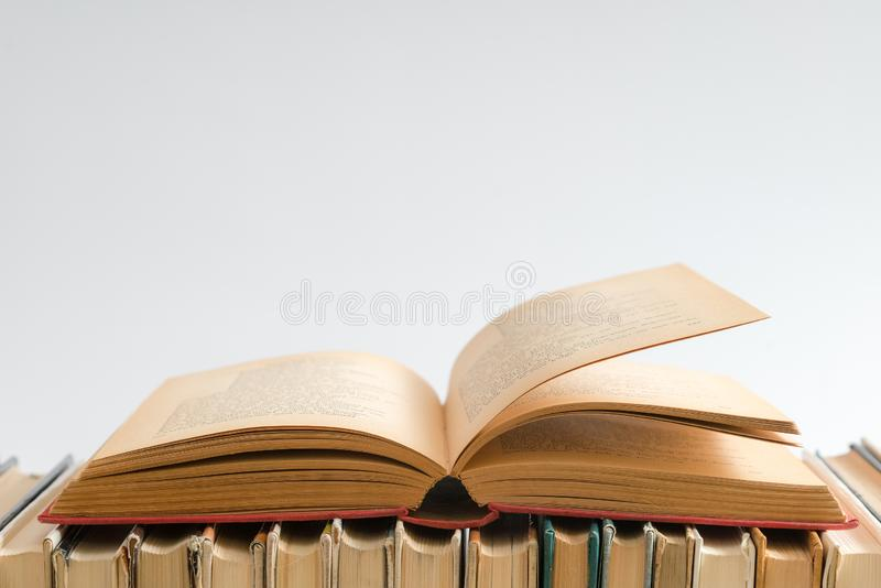 Open book on white background, hardback books on wooden table. E. Ducation and learning background. Back to school, studying. Copy space for text royalty free stock photo