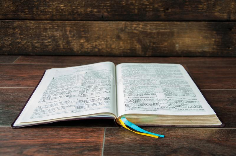An open book on a wooden table. Bible on wooden background royalty free stock photography