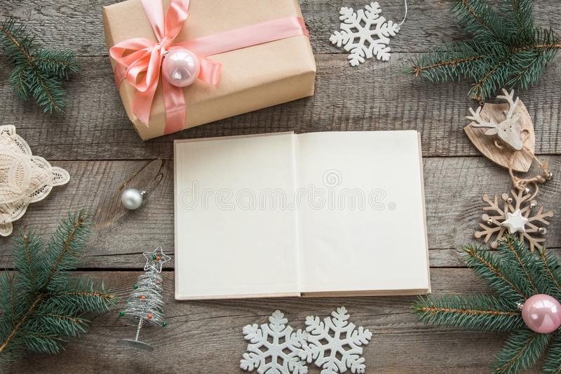 Open book for you Christmas wishes. Preparation for Christmas holiday. Still life. Christmas gift box with pink ribbon and around. Preparation for Christmas stock images