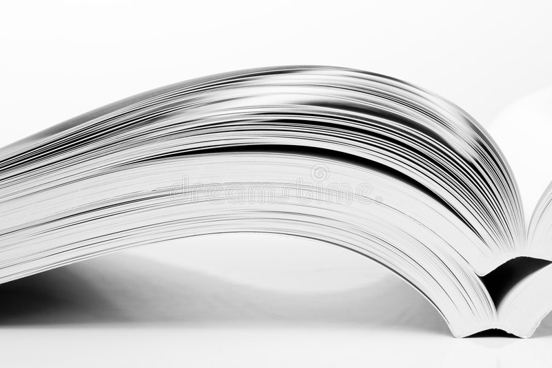Open books. On white table stock images