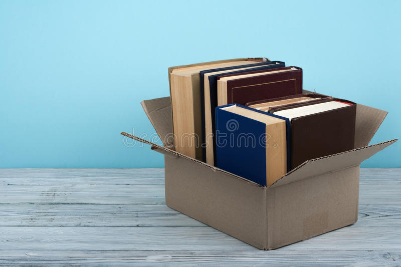 Open books on on wooden deck table and blue background. Back to School. Education concept with copy space for your ad royalty free stock photography