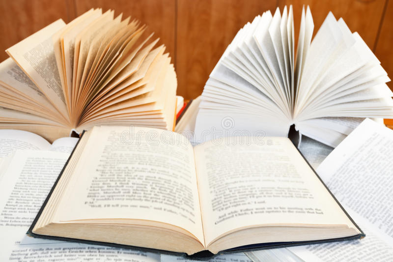 Open books on wooden table. Fan open books with blur font on wooden table stock image