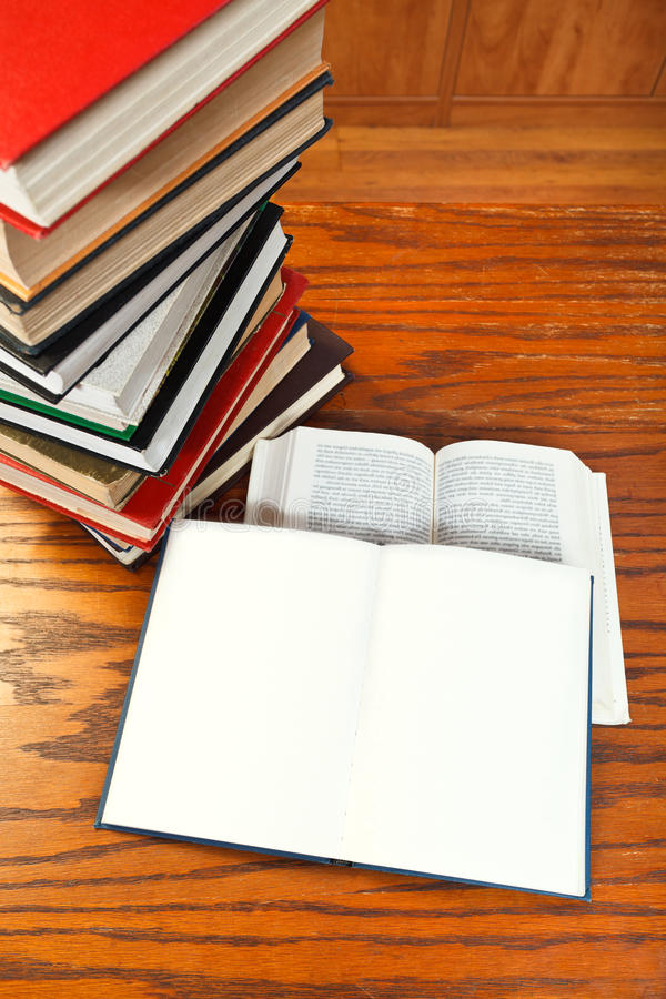 Open books on wooden table. Two open blank and blur font books on wooden table stock photography