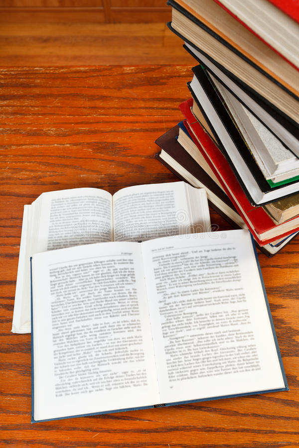Open books on wooden table. Two open books with blur font on wooden table stock photos