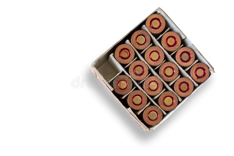Open box of gun cartridges on isolated background. One cell is empty as a concept of used bullet. Closeup image of ammo royalty free stock photography