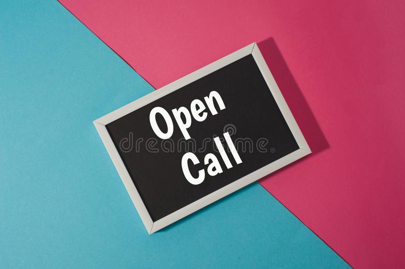 Open call - text on chalkboard. On blue and pink bright background royalty free stock images