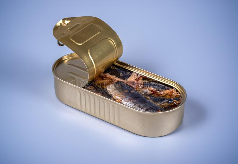 Open canned food with smoked herring royalty free stock photos