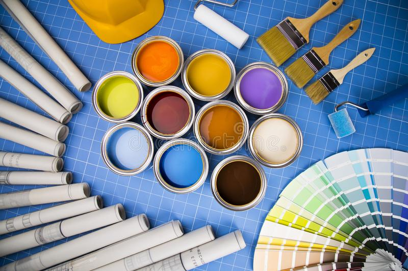 Open cans of paint,Brush, blue background royalty free stock image