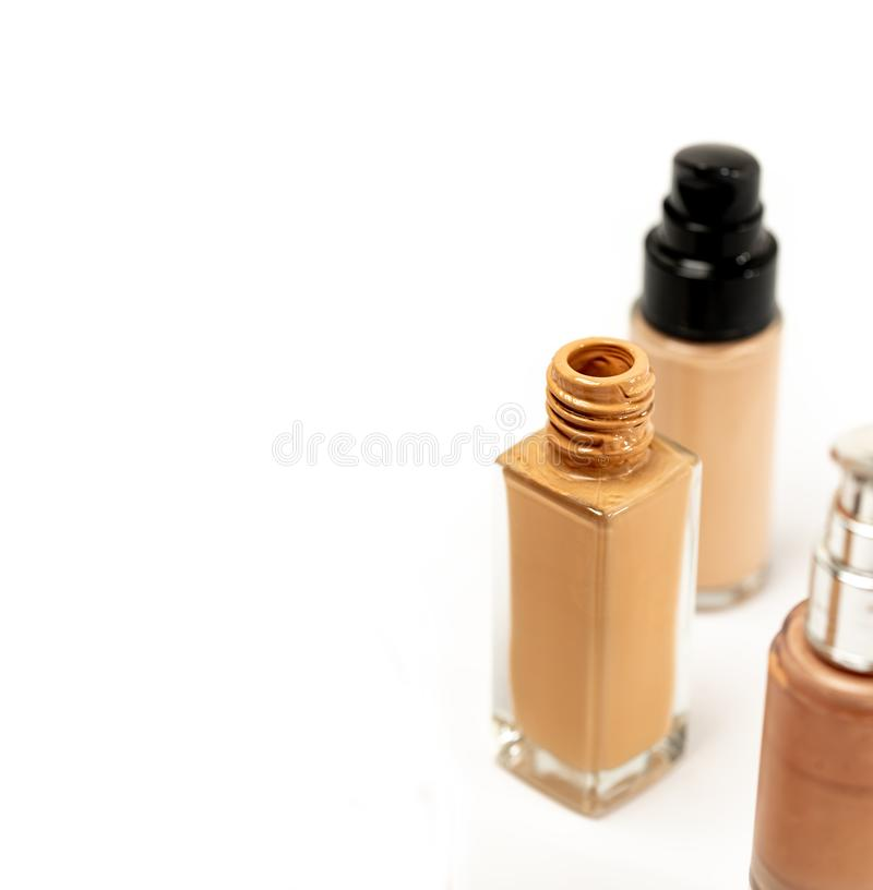 An Open Cap Cosmetic Foundation Bottle on White Background. Liquid Foundation Glass Container. Selective stock images