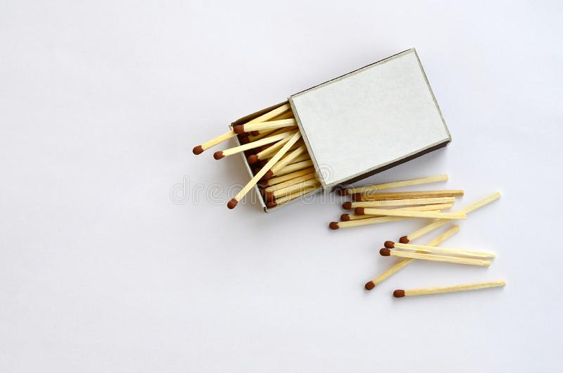 Open cardboard matchbox filled with matches on a white background royalty free stock photo