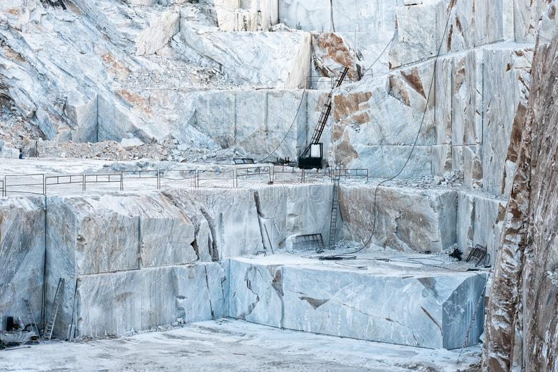 Open cast mine pit with white Carrara marble stock photography