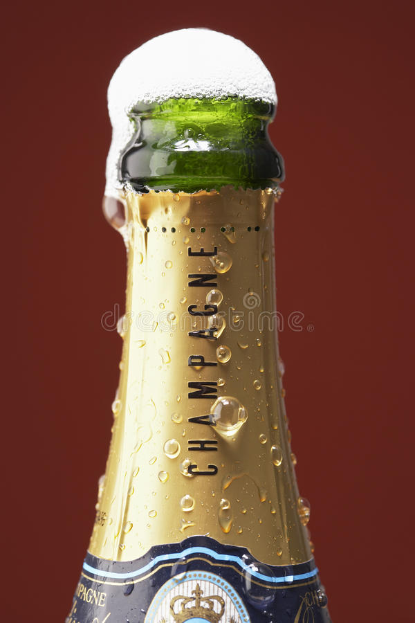 Open champagne bottle overflowing stock image