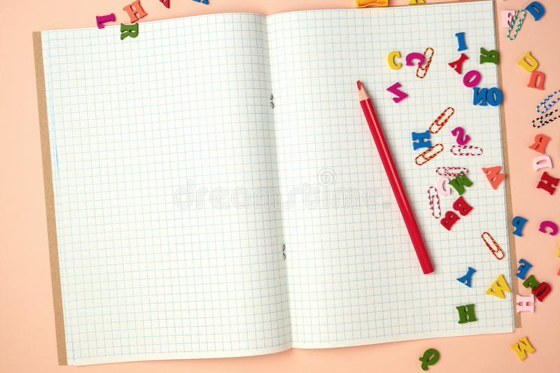 open checked notebook and red wooden pencil stock photos