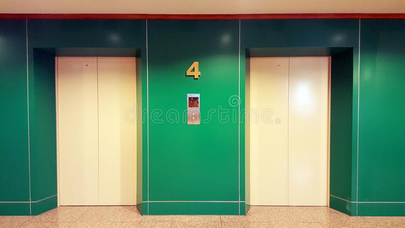 Open and closed chrome metal office building elevator doors realistic photo. Lift transportation floor to floors with push switch stock image
