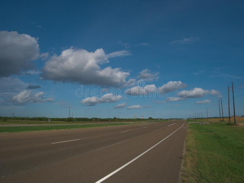 Open Country Road with No Cars on a Beautiful Sunny Day royalty free stock photos