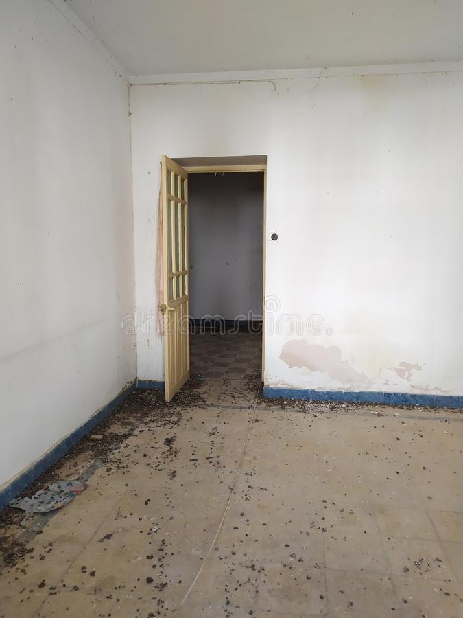 Open door in abandoned house stock photo