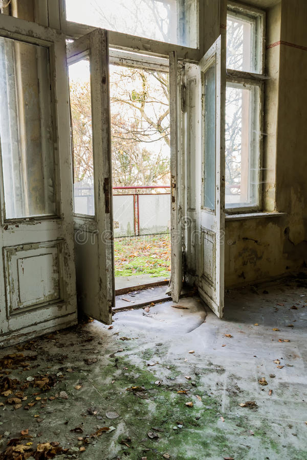 Open the door in an abandoned room royalty free stock photography