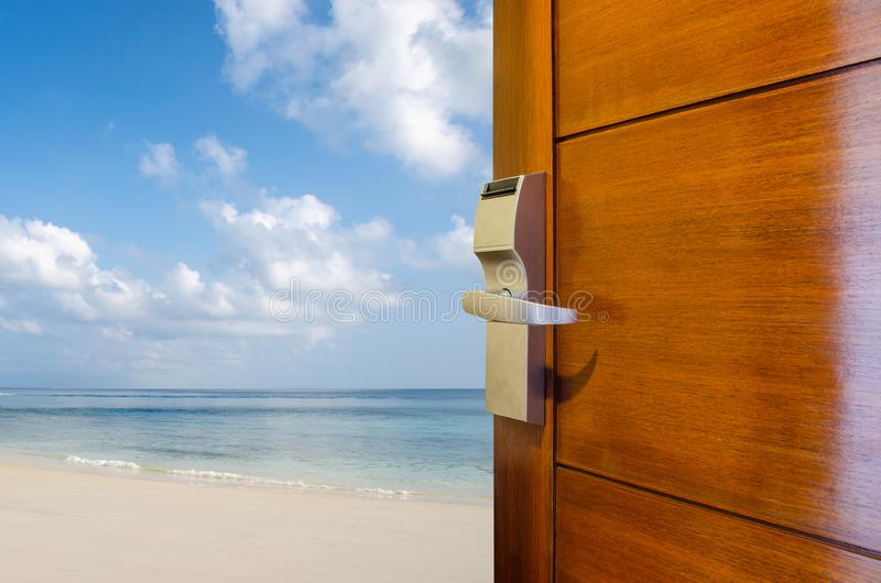 Open door with access to the beach, the concept of leisure, travel and holidays, Dream and imagination concept. A Open door with access to the beach, the concept stock image