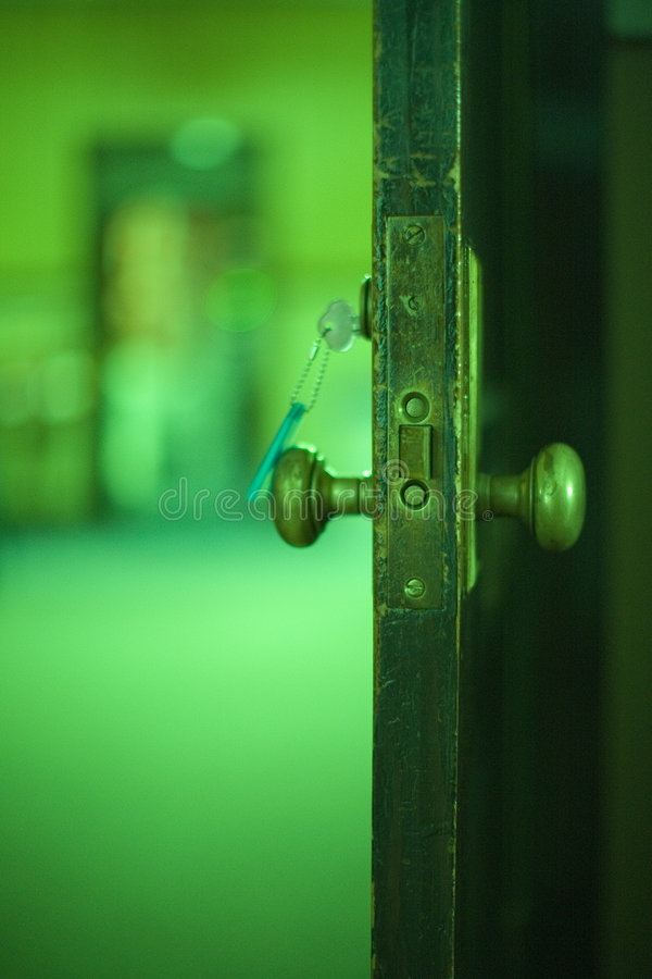 Open door, green tint stock image