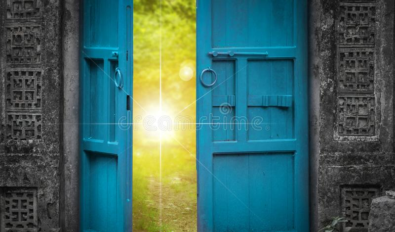 Open door and heaven light. Open blue door and sunshine. imagination concept royalty free stock photo