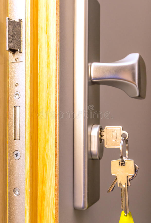 Open door with keys,. Key in keyhole royalty free stock photography