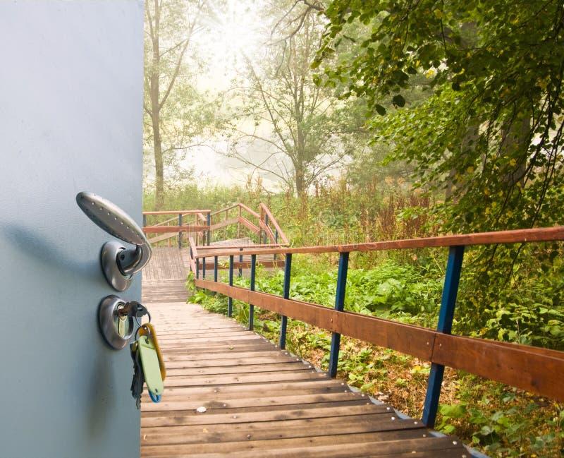 Open door ladder royalty free stock images
