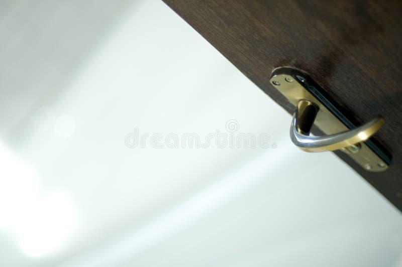 Open Door with Lever Handle. An open door with a lever handle royalty free stock images