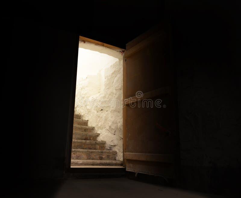 Open door in spooky dark basement stock photos