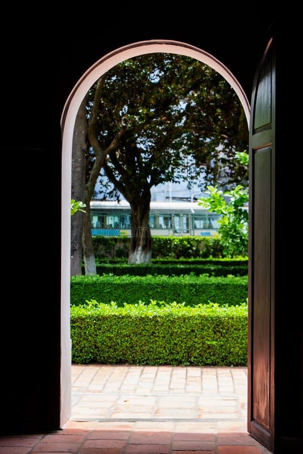 Open door to garden stock photo