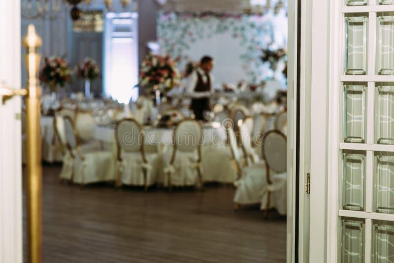 Open door to the luxury restaurant for wedding stock image