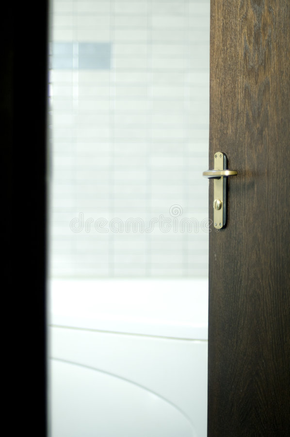 Open Door to Opportunities. A door open leads to an office or new opportunities royalty free stock photos