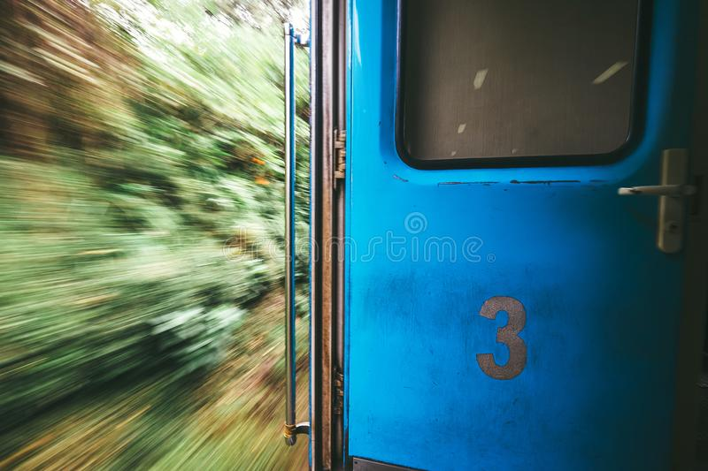 Open door in train wagon during it moving royalty free stock photography