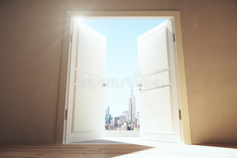 Open doors from empty room to megapolis city with skyscrapers. Close up royalty free stock photography