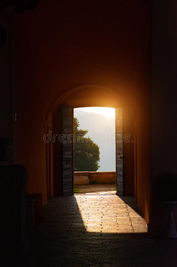 Through the open doors in the sunlight breaks an ancient fortress. Italy, Angera. Castle Rocca di Angera. royalty free stock photography