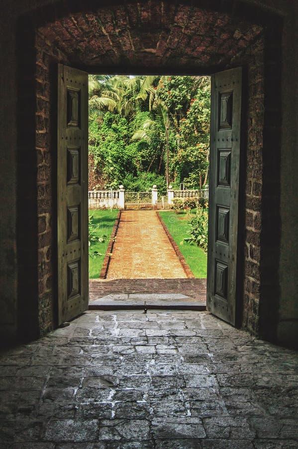 Open doors to the tropical garden at villa royalty free stock photography