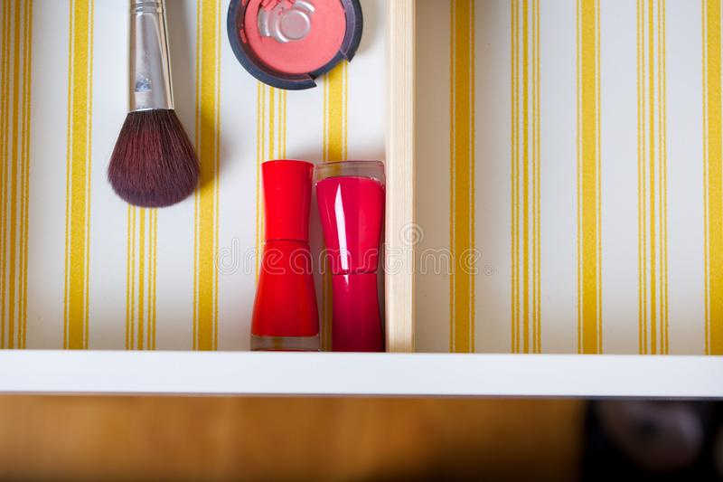Open drawer of a woman's mirror table. Closeup stock photography