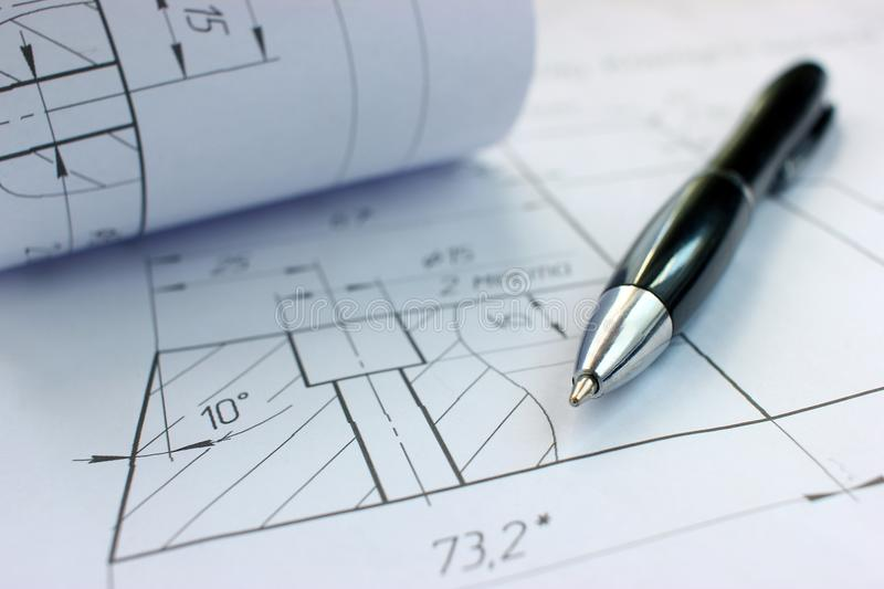 Open drawings with a pencil. Engineering and design. Construction projects royalty free stock photos