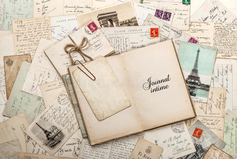 Open empty diary book, old letters, french postcards stock photography