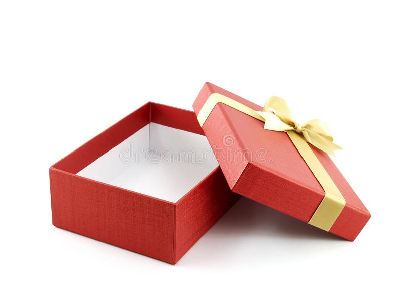 Close up single open and empty red gift box with golden ribbon bow on white background royalty free stock image