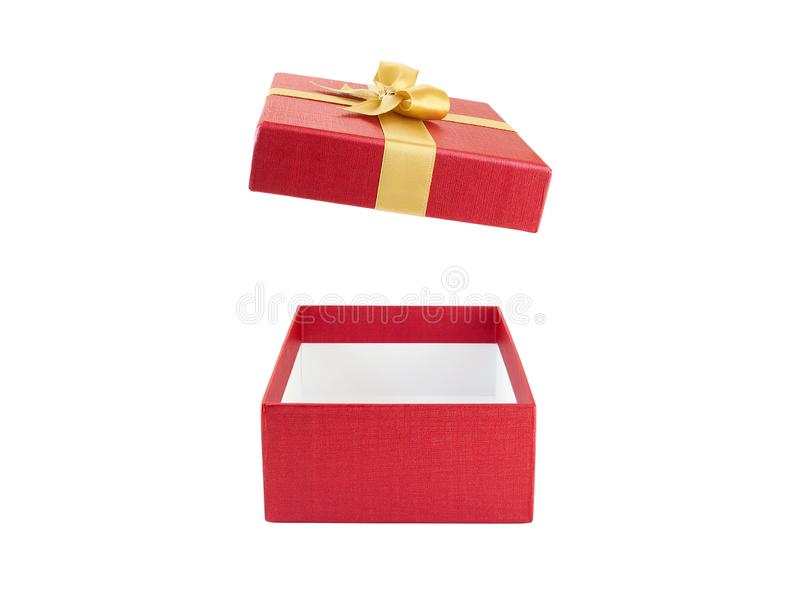 Close up open and empty red gift box with yellow gold ribbon bow isolated on white background stock images