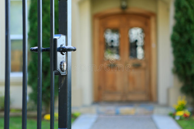 Open entrance iron gate stock photography