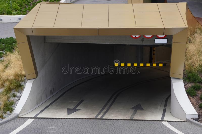 Open entrance to the underground Parking, modern Parking under the building, saving space in the city. car protection, safety. Open entrance to underground stock images
