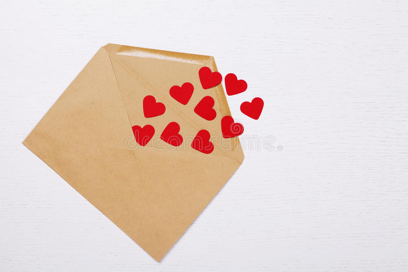 Open envelope with paper hearts inside royalty free stock images