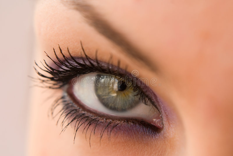 Open eye. Beautiful woman`s open colorful eye