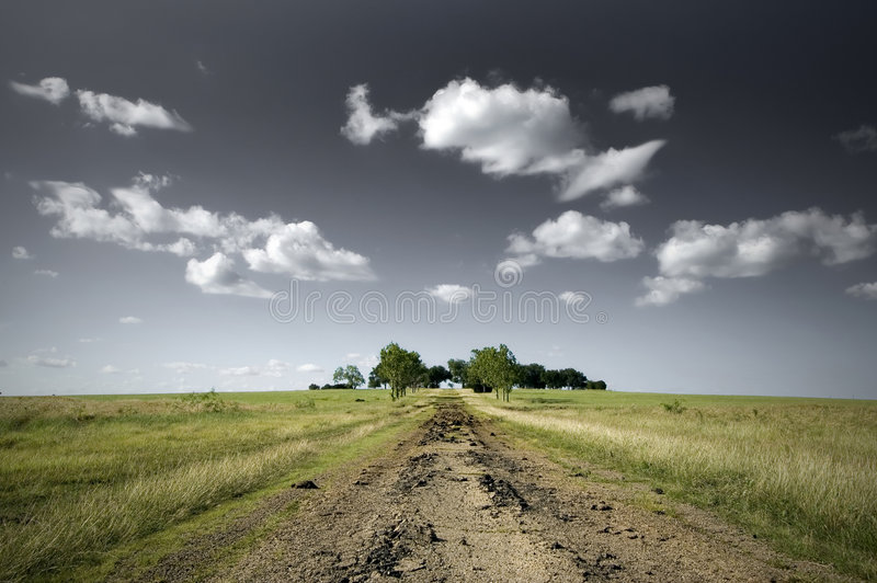 Open Field And A Dirt Road Royalty Free Stock Photos