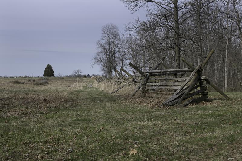 Gettysburg Battlefield with Split-rail Fence. Open field at Gettysburg Battlefield with split-rail fence. Also known as a zigzag fence, worm fence or snake fence royalty free stock photo