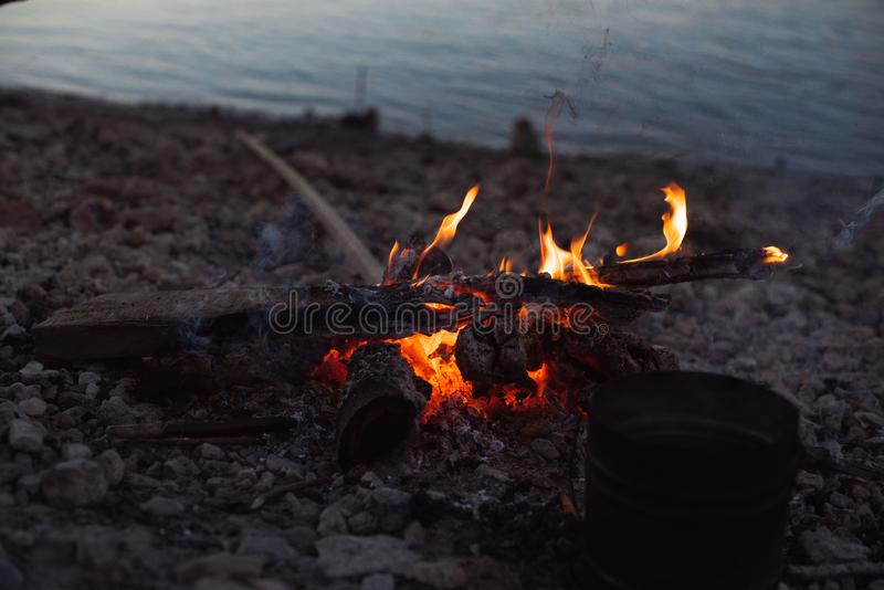 Camping. bonfire on the beach. royalty free stock images