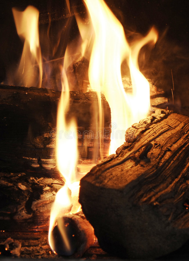 Open fire - fireplace. Open fire, burning logs in a fireplace royalty free stock photos
