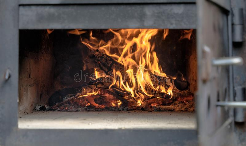 open, fire, fireplace, heat, heating, burn, place, high, yellow, flame, flames, log, wood, buschwood, element, natural, snug, oran stock image