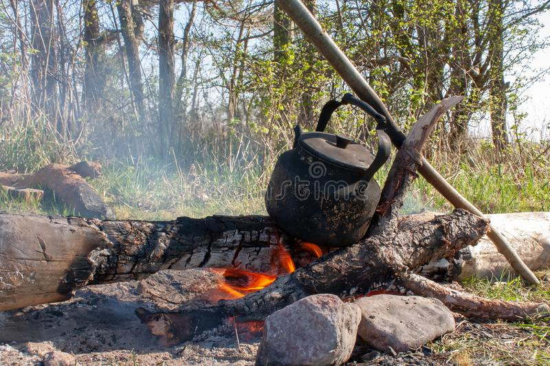 Open fire hiking kettle. Hiking kettle, on an open fire royalty free stock image